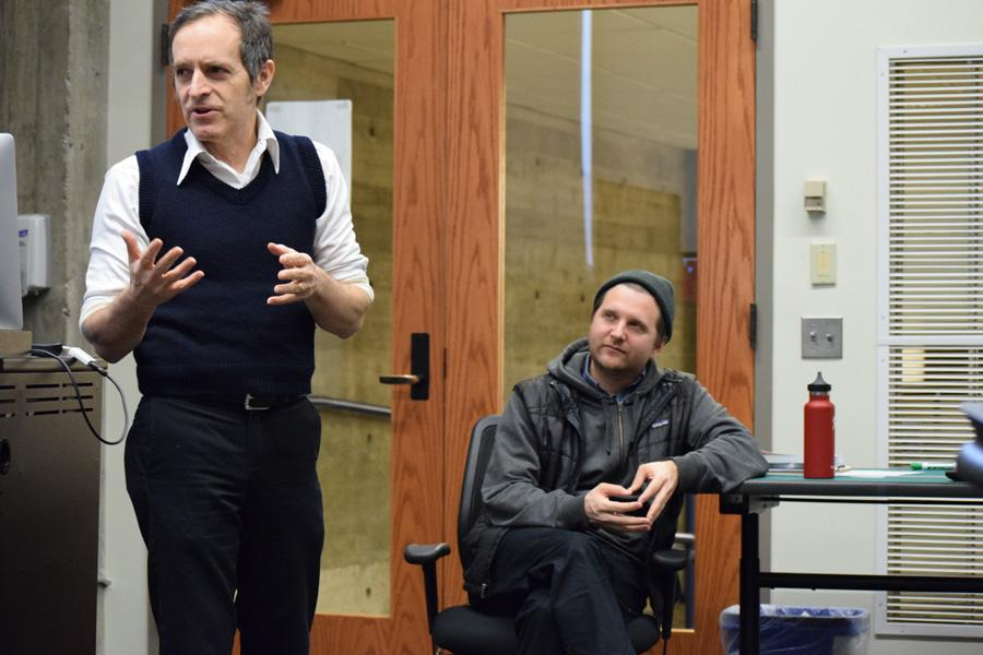 Left, visiting filmmaker Cory McAbee speaks to a group of students and faculty in Bush Memorial Library on Friday, Feb. 5. Right, adjunct professor Richard Pelster-Wiebe watches and listens intently.
