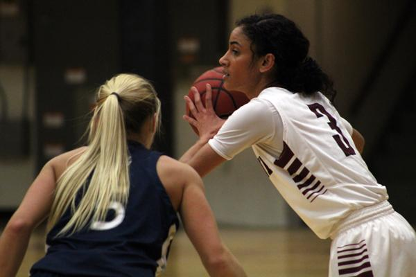 Senior point guard Chloe Graves (3) holds the ball in Hamline's 63-70 defeat to UW-Stout.