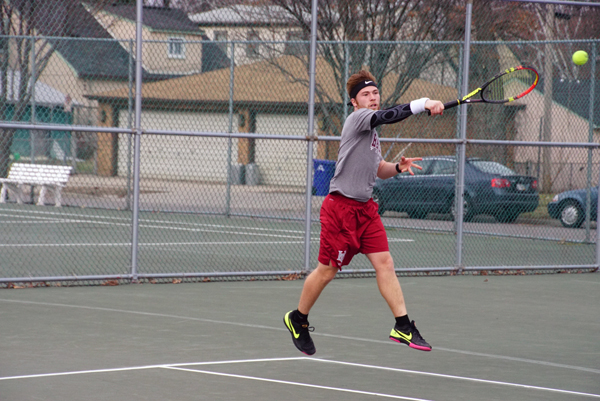 Junior Brandon Kuether returns a ball during one of his two singles matches last Saturday. Kuether lost both of his matches, but Hamline managed to split their matches on the day.