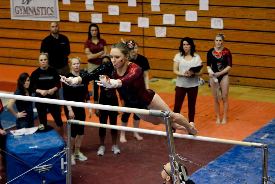 Senior Courtney Benson performs a mount on the uneven bars. She won the NCGA Outstanding Senior Athlete Award to end  on a high note.