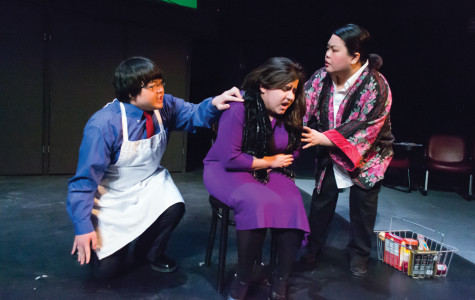 """Left to right: First-year Lee Mai, junior Kyrie Carlson and senior Phasoua Vang act in Hamline Theatre's play """"Crocodile Seeking Refuge,"""" which tells the story of refugees in search of asylum in the United Kingdom."""