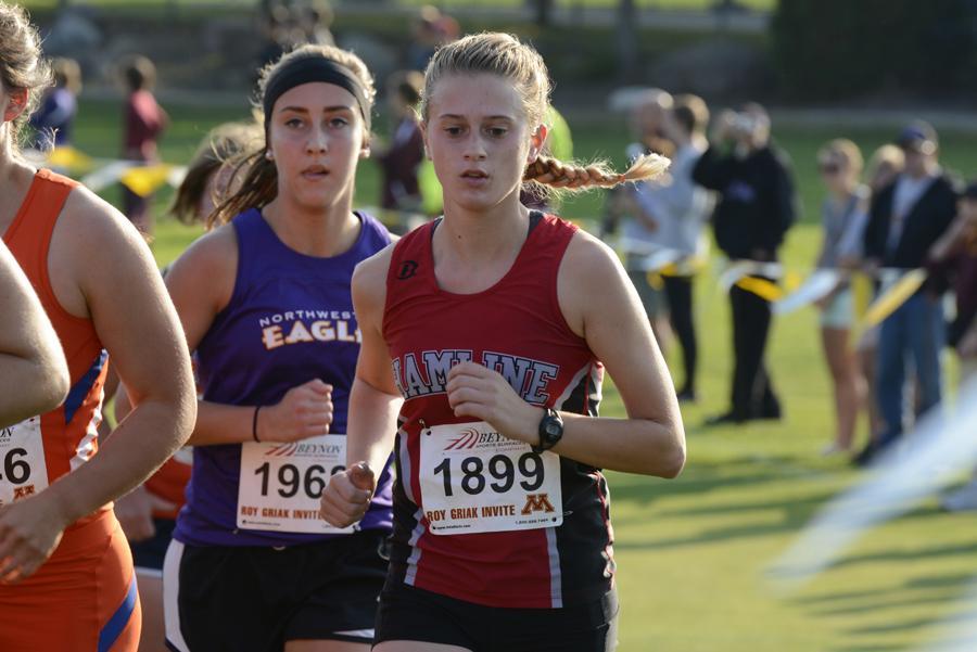 Junior Brenna Kennedy running for women's cross  country.