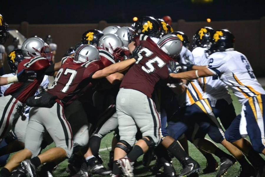 The Hamline Pipers battle the Carleton Knights on Sept. 21. (Photo by Gino Terrell)