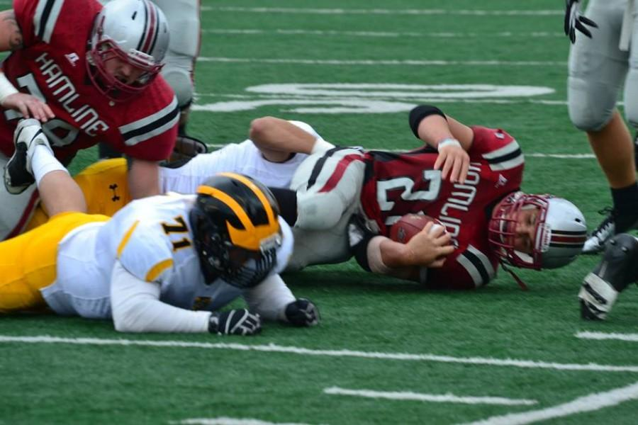 Sophomore Austin Duncan tackled by the Gusties after rush attempt. (Photo by Gino Terrell)