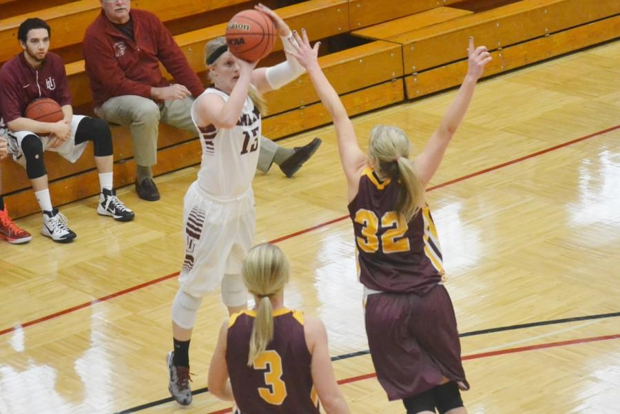 Senior Jordan Sammons on the three point shot attempt against the Concordia Cobbers on Dec. 6, 2014. Sammons finished the night with 24 points.