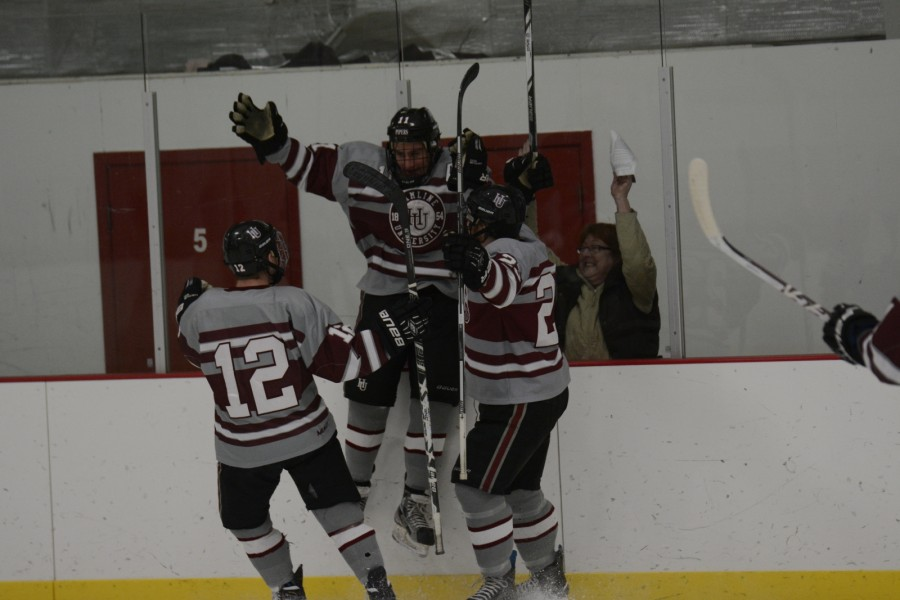 Junior forward and assistant team captain Kevin Novakovich (11) celebrates with the Pipers.