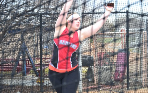 Senior Jessica Putland throws at Klas Field at last year's Meet of UnSaintly on May 2, 2014. Piper track and field will return to Klas Field on April 10 and 11 for the HU Invite.