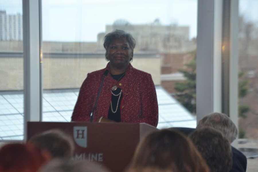 Dr. Fayneese Miller is greeted with an applause as she steps to the podium after being formally announced as Hamline University's 20th President  in Klas Center, Kay Fredericks Room on April 7, 2015.