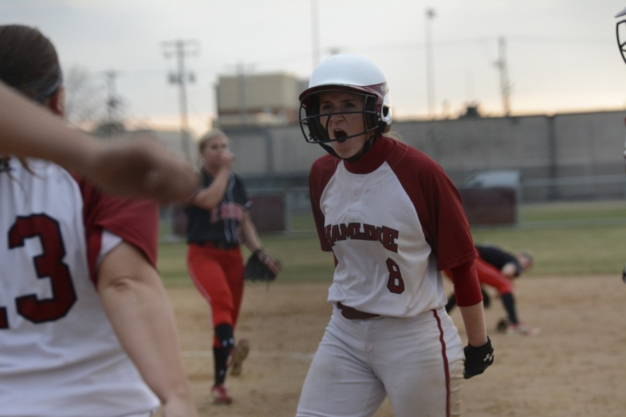 Junior Jamie Rubbelke celebrates after scoring a run for the Pipers.