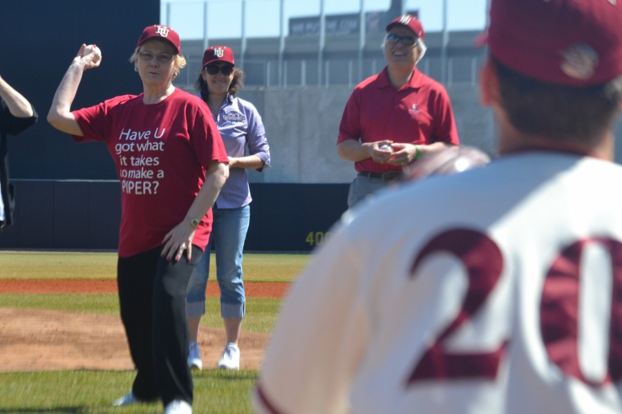 Hamline University's President Linda Hanson throws out the first pitch to junior pitcher Aaron Stoneberg before the first ever game played at CHS Field on April 11, 2015.