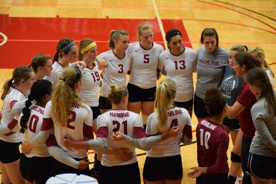 The Piper volleyball team during a timeout against Martin Luther on Wednesday, Sep. 9.