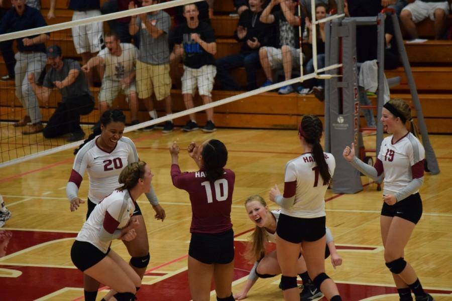 Pipers celebrating a big point before losing to St. Mary's, 1-3 on Wednesday, Sep. 23.