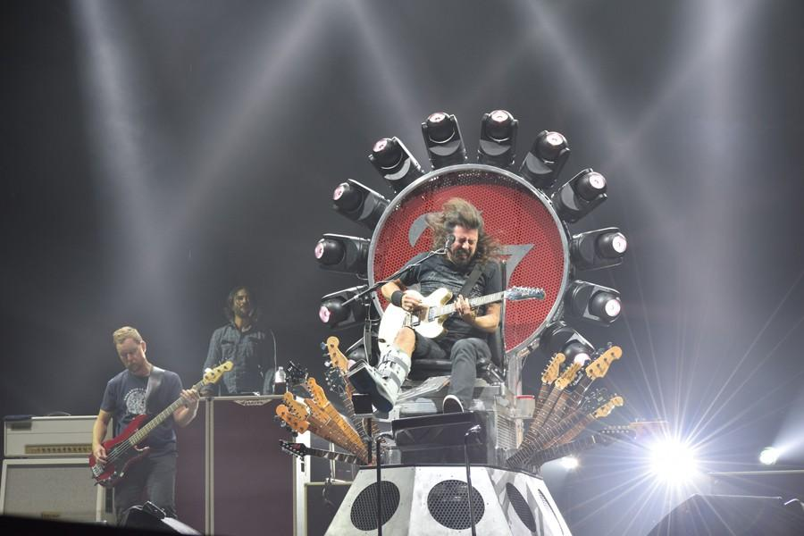 Foo Fighter Dave Grohl headbanging and strumming his guitar while performing for 15,000 fans.