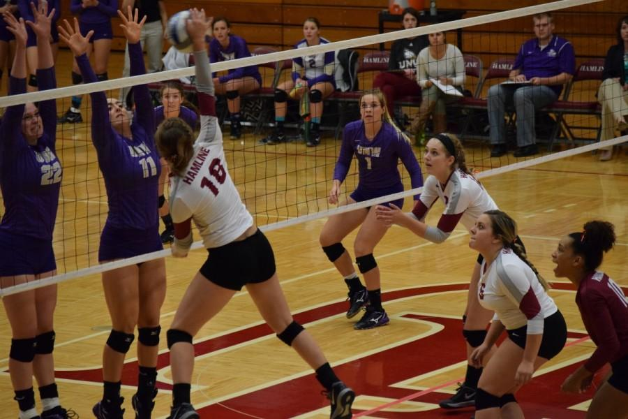 Junior Julia Zolnosky elevating over the net for a kill against Northwestern (MN) on Friday, Oct. 9.