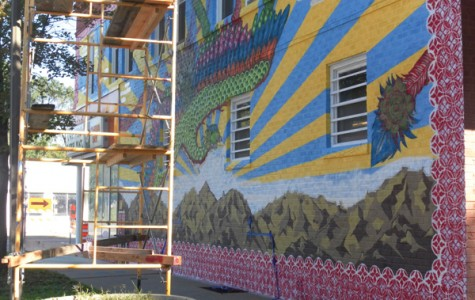 The mural on Snelling and Van Buren currently has parts of the background and sun covered until the changes are made.