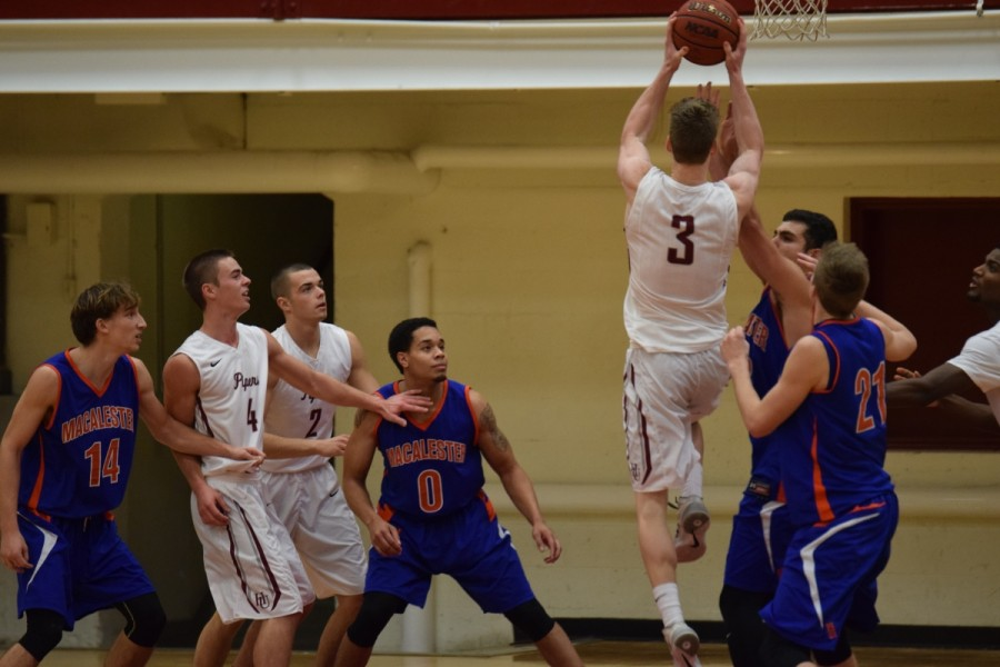 Junior forward Dylan See-Rockers extending over Scot defenders to get a basket. He scored 16 points against Macalester and claimed five rebounds.