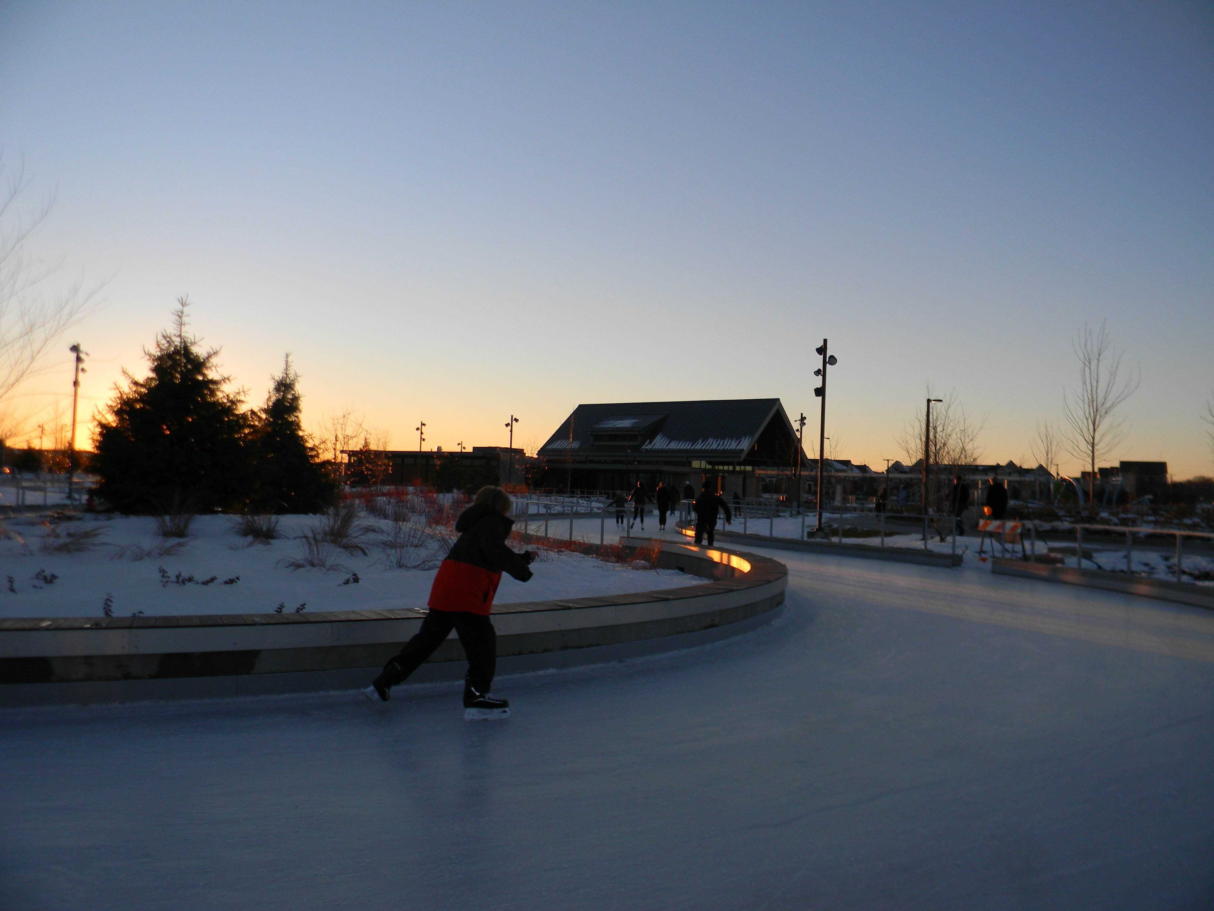 Skaters whiz along the newly opened, 810-foot-long skating loop at the Central Park of Maple Grove.