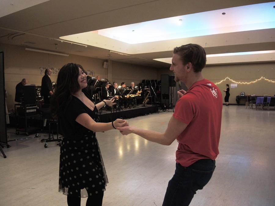 Leah Rathe swing dances with Andy Magnuson at this year's Swing into Spring Dance in Bush Ballroom last Friday.
