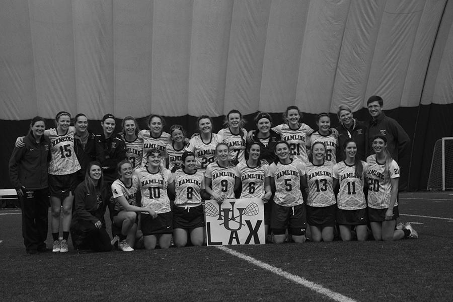 The team poses for a photo after their first win on Feb. 21.