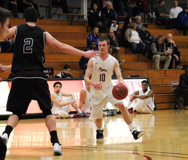 Junior guard Zach Smith (10) presses the attack against Augsburg in Hamline's 60-69 defeat to the Auggies.