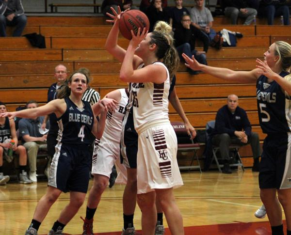 First-year forward Aly Sartain (25) attempts one of her three shots in Hamline's 63-70 home defeat to UW-Stout.