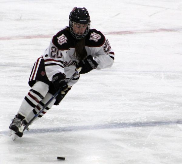 First-year Bre Simon carries the puck into the offensive zone in Hamline's 2-3 OT defeat to UW-Eau Claire.