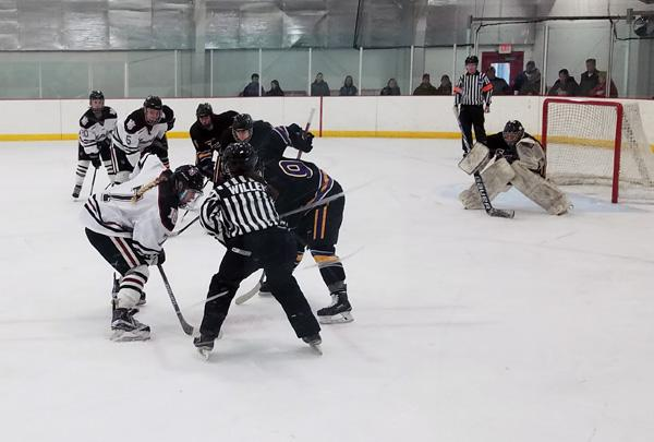 Sophomore forward Brede Postier takes a draw against a St. Kate's player in Hamline's 1-2 loss at home to St. Kate's. The Pipers split the home-and-home series with the Wildcats.