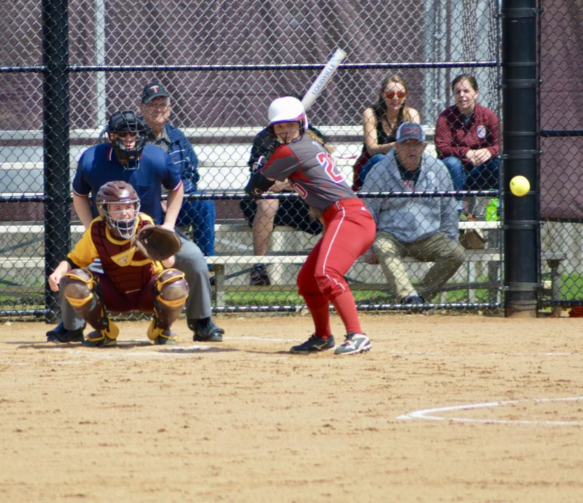 Junior catcher Abbie Annen watches a pitch come in against Concordia.