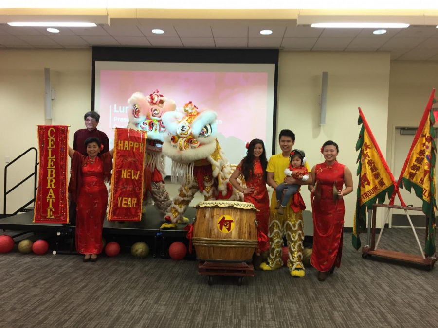 Members+of+the+Ha+Family+Lion+Dance+Troupe+pose+after+performing+a+traditional+Chinese+lion+dance.