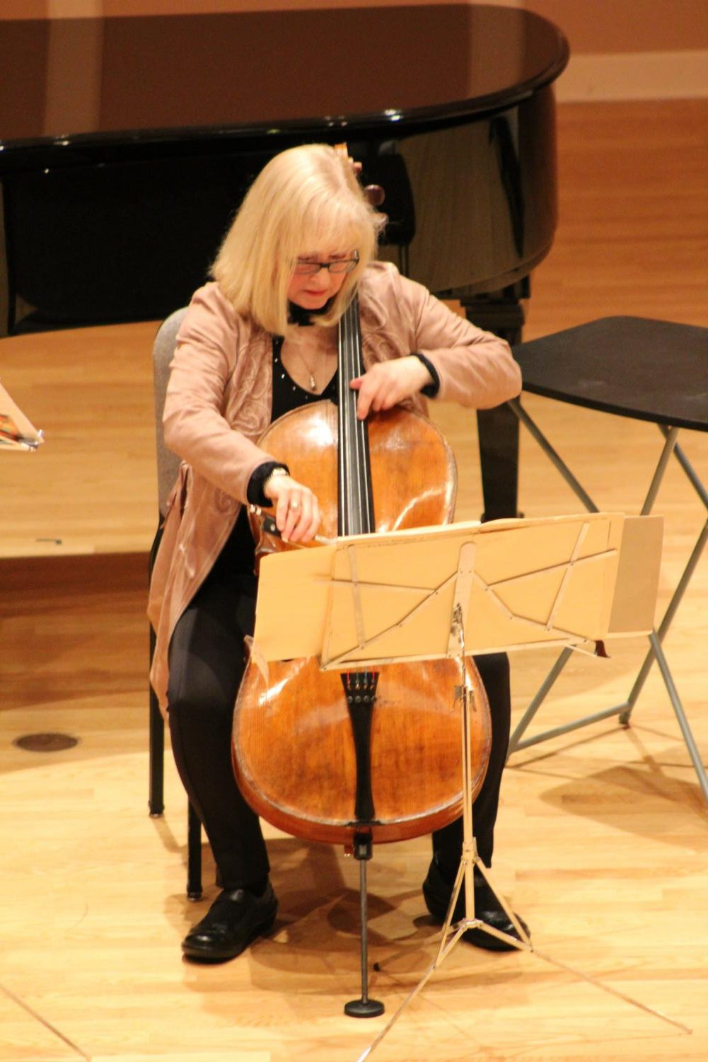 Janet Horvath plays the cello during key moments of the presentation.