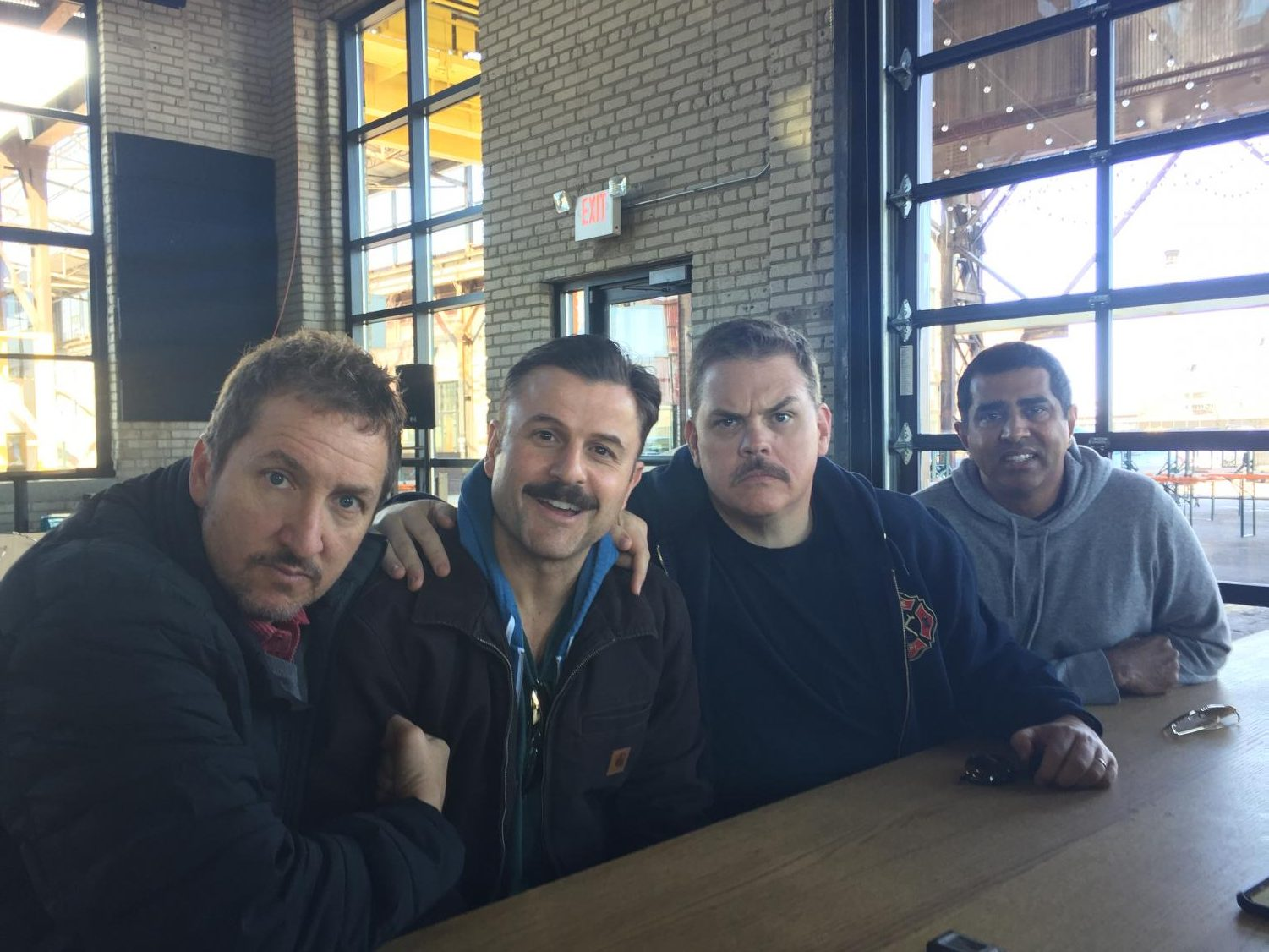 "Preceding the roundtable discussion, four of the five ""Super Troopers""- Paul Soter, Steve Lemme, Kevin Heffernan and Jay Chandrasekhar pose for a picture."