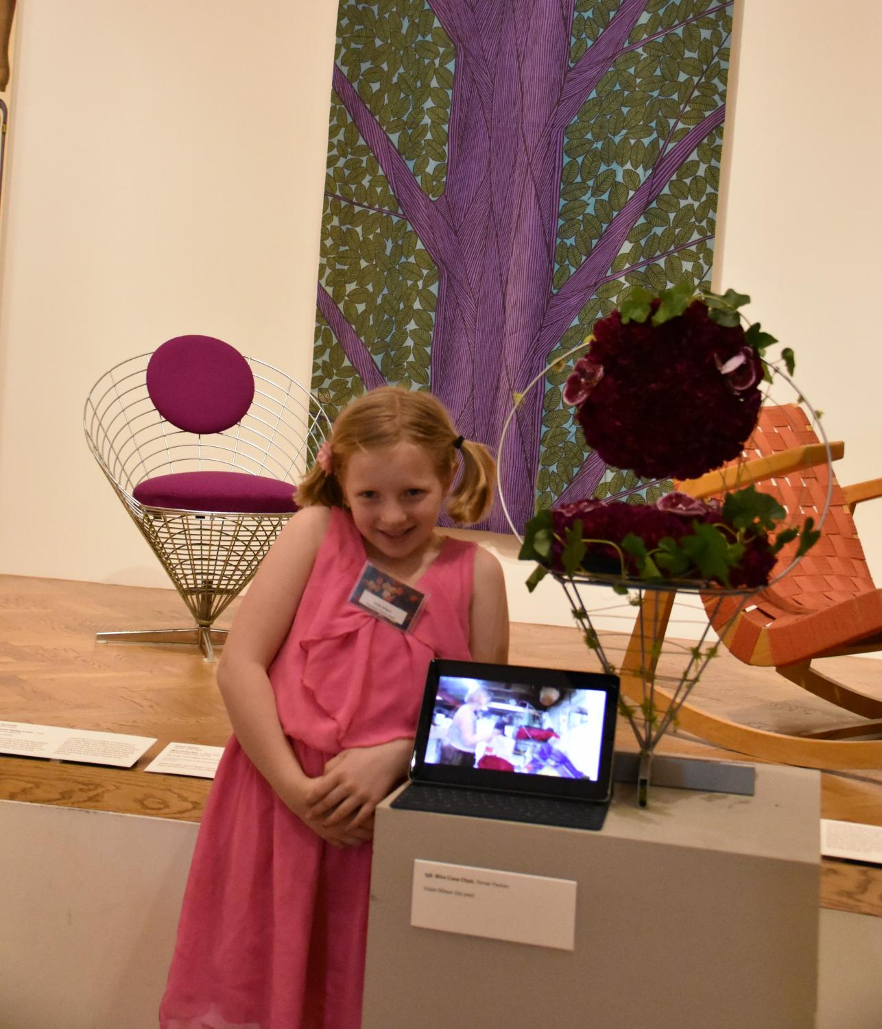 Violet Wilson stands beside her finished piece and the chair that inspired it, showing off the timelapse to prove she did it all by herself.