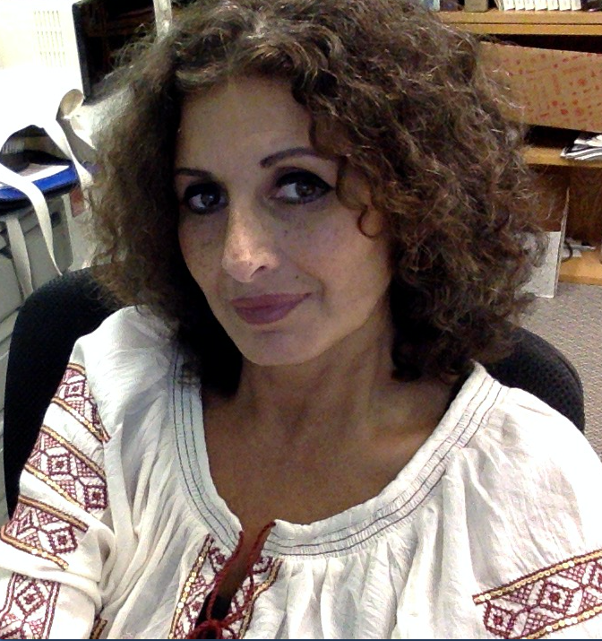 Professor Aida Audeh sitting in her office.