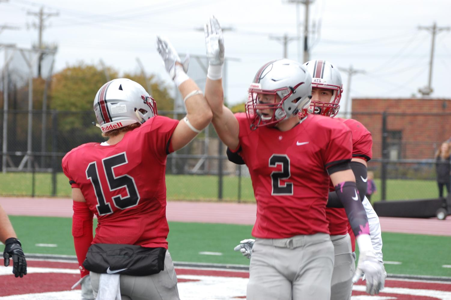 Seniors Jordan Deno and Dalton Pakkala celebrate after a big play.