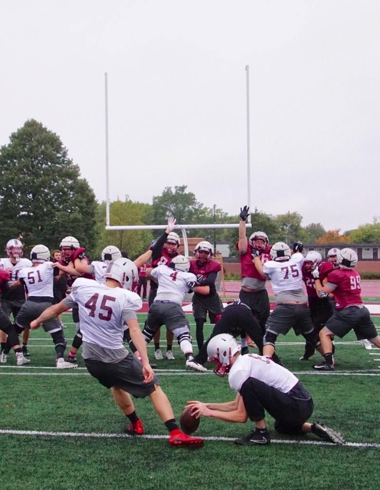 Hamline football team practices field goals.
