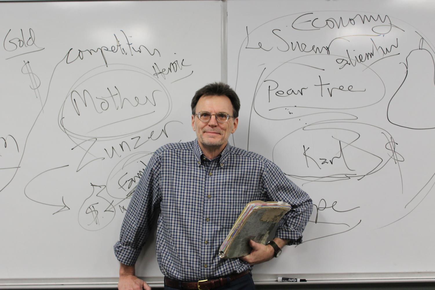 Mark Olson stands in front of his signature board of notes.