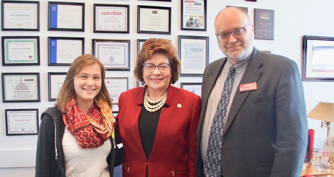 Senator Carla Nelson with one of her constituents, Theresa Kallmes, and Hamline's Director of Communications, Jeff Papas.