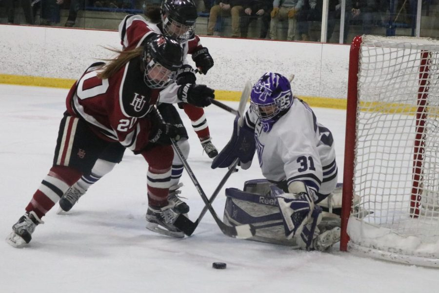 An opportunity arises for junior Bre Simon as she tries to find an opening between the Tommies' goalie and the net.