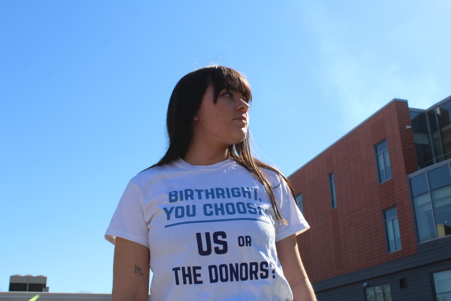 Anna O'Neill stands proudly in her IfNotNow tee.