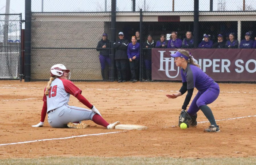 First-year Theresa Klinnert slides to safety during the game against St. Mary's.