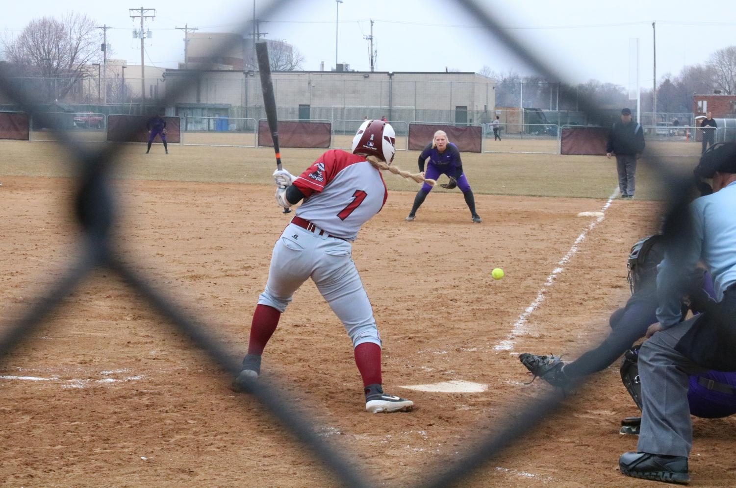 First-year Lauren Sotnyk hits a line drive toward first base.