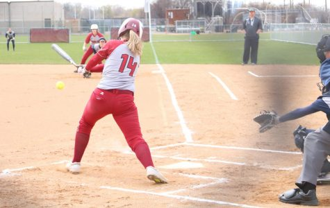Senior Delaney Kohler swings for the ball in a game against Carleton College on April 27.