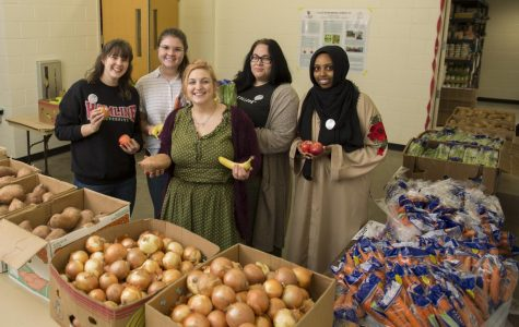 Feed Your Brain members and volunteers at one of their monthly pop-up pantries. Pictured from left to right, sophomore Maggie Bruns, senior Emma Kiley, senior Maddie Guyott, senior An Garagiola and sophomore Najma Omar.