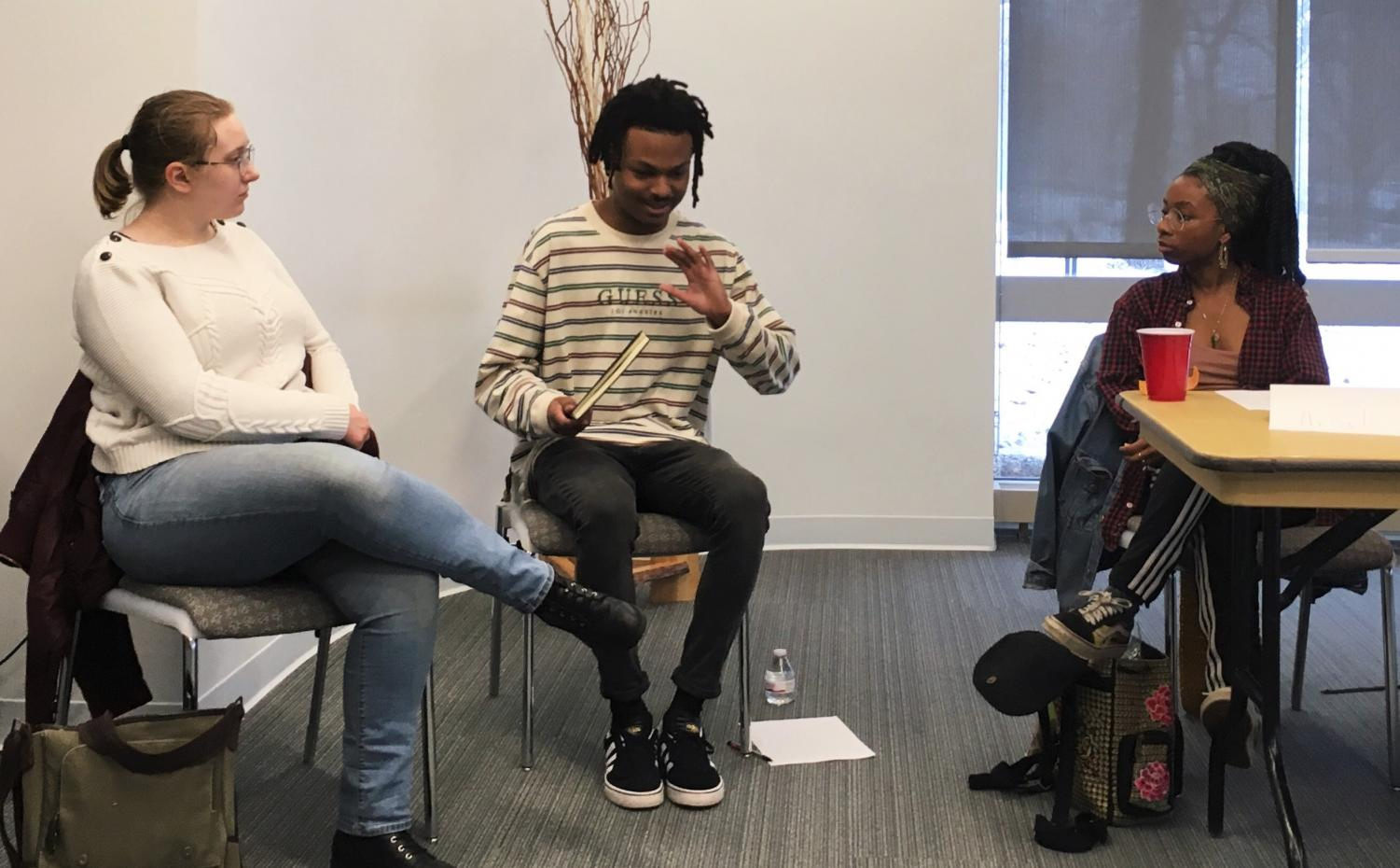 From left, sophomore and co-coordinator Frances Verner; sophomore, co-coordinator and host Stef Holland; and senior and panelist Aria Gilliam speak at the Evening of Entropy panel on April 10.