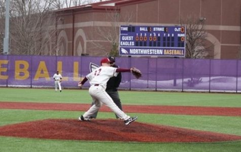 Hamline junior Ben Resnick, the Piper's left-handed pitcher, winds up a pitch.