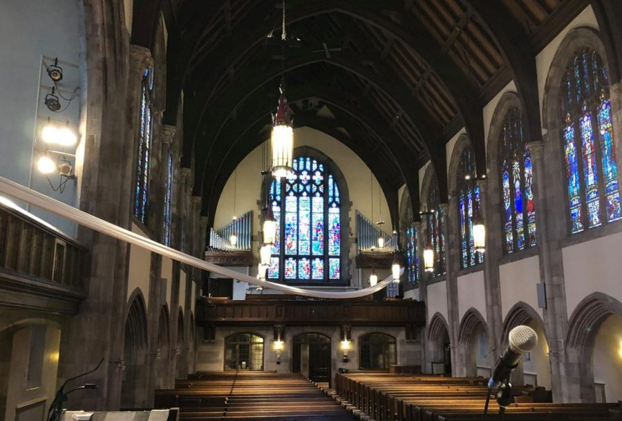 Hamline Church's interior boasts Gothic design, with stained-glass windows and wood-covered steel beams.