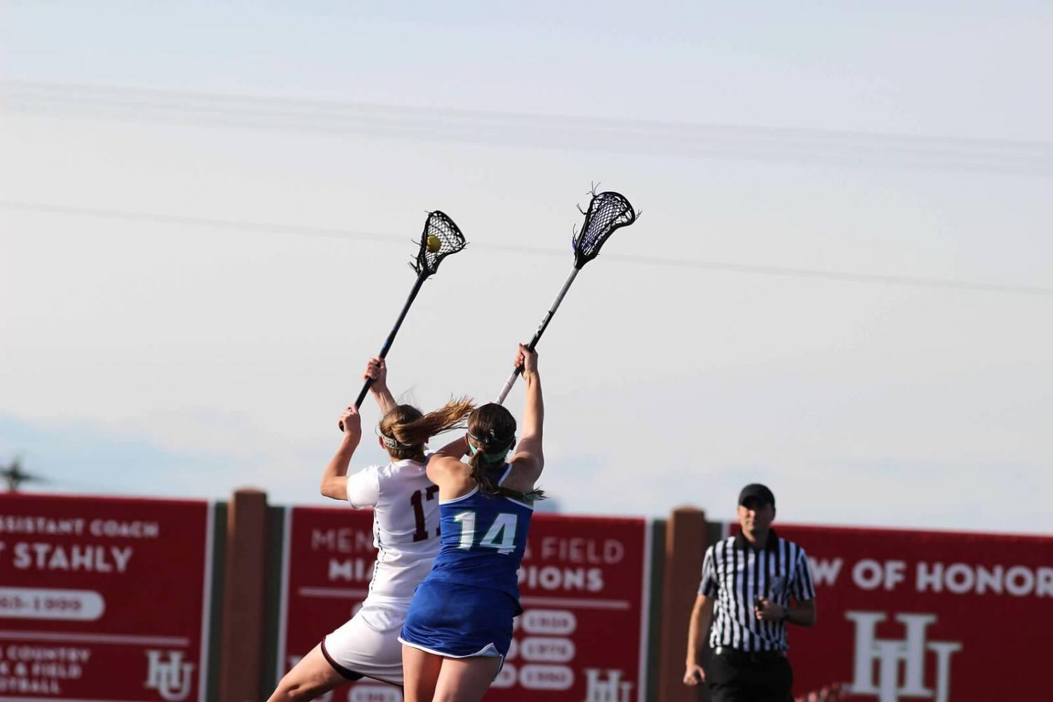 Junior Brayden Maass gets the ball during the Midwest Women's Lacrosse Championship game against Aurora on May 4, 2019.