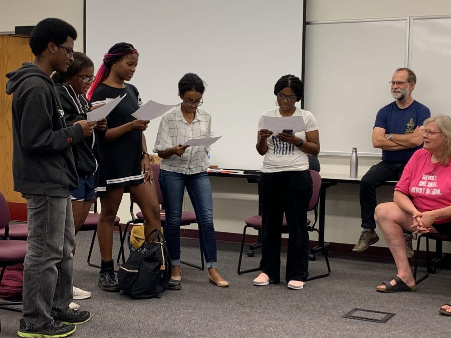 Actor Patrick Bailey and Director Wendy Knox (right) watch students read a scene from Frank Theatre's Escaped Alone and Here We Go in PBHL 3980: Health and the Environment at Hamline University.
