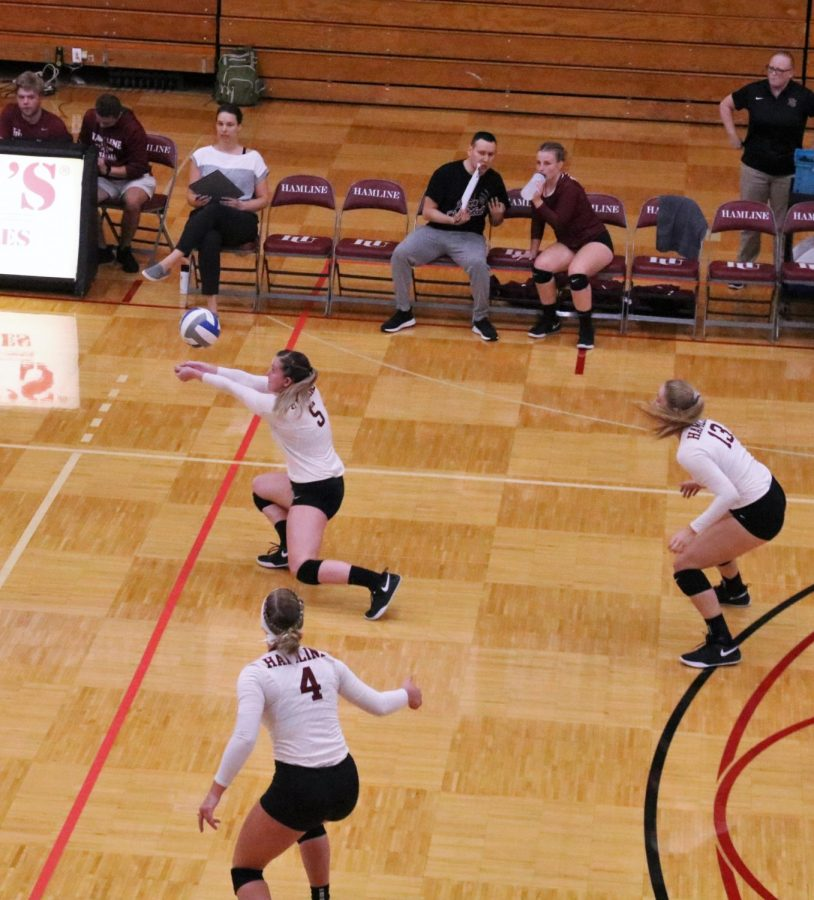 Senior Morgen Coleman (#5) reacts to serve from opposing team.