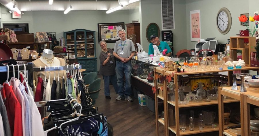 From left, owner Melody Luepke stands with volunteer John Sponsel and her husband, Charlie Luepke in the newly opened Flying Pig Thrift.